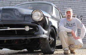 Kirt Rebello with his Kustom 1954 Chevrolet that he built.